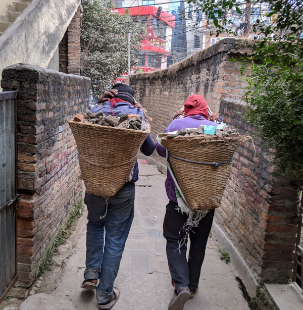 Kathmandu construction material being moved in doko baskets