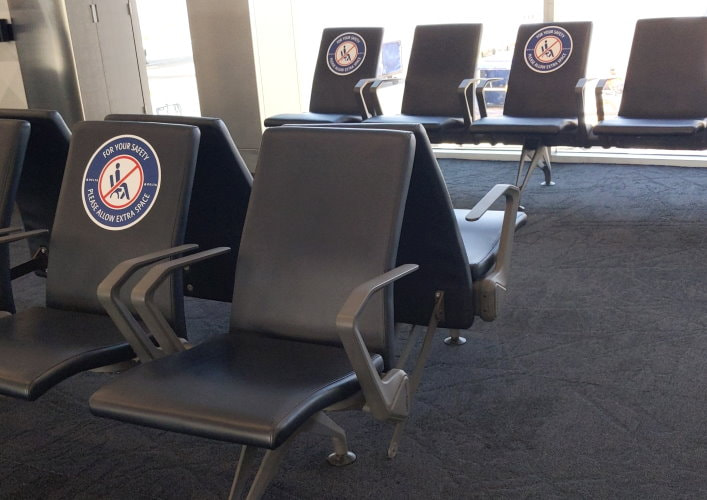 Airport Waiting Area Seats Blocked Off for Social Distancing
